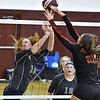 (Brad Davis/The Register-Herald) Independence's Lexi Bolen tries to tap the ball back over as PikeView's Olivia Boggess tries to block it during Shirley Brown Invitational action Saturday morning at Woodrow Wilson High School.