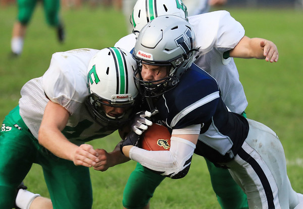 Valley's (1) is tackled by Fayetteville's Eli Selvey (4) during the first quarter of their high school football game Friday in Smithers. (Chris Jackson/The Register-Herald)