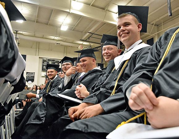 (Brad Davis/The Register-Herald) Graduating Westside seniors look on and laugh as classmates give their their speeches during the school's 2018 Commencement Ceremony Sunday afternoon in Clear Fork.