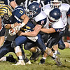 (Brad Davis/The Register-Herald) Shady Spring's Tyler Bragg drags Independence defenders Hunter Williams (#8), and Andrew Martin (#10) with him for a few yards before finally being taken down Thursday night in Shady Spring.
