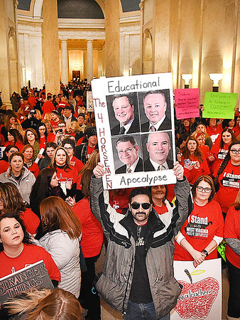 Teachers acsross the state rally in front of the Senate chambers at the State Capitol in Charleston Friday morning and they filled the gallery and others chanted outside the chamber as the state Senate unanimously passed a bill that would increase teachers and certain state employees salaries by 1 percent.<br /> (Rick Barbero/The Register-Herald)