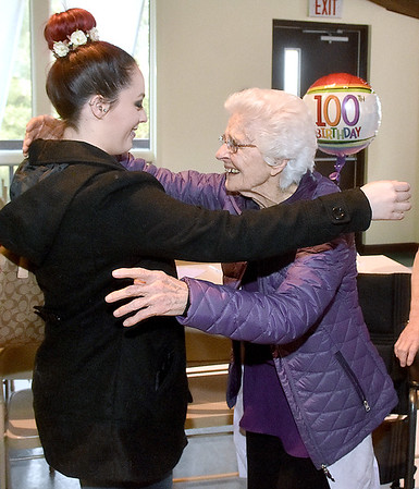 (Brad Davis/The Register-Herald) Ghent resident Florence Mandakunis is greeted with a hug by her great granddaughter Ashley Mandakunis during the opening moments of her 100th birthday party Saturday afternoon at Calvary Assembly of God.