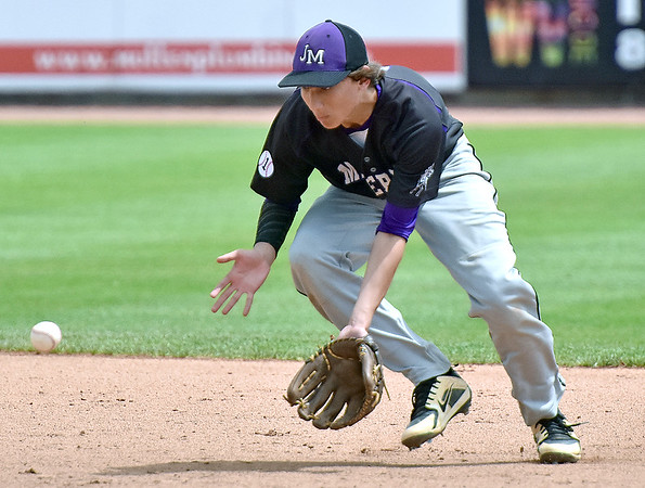 (Brad Davis/The Register-Herald) James Monroe shortstop Nicholas Jewell fields a ground ball against Bridgeport Friday afternoon at Appalachian Power Park in Charleston.