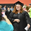 (Brad Davis/The Register-Herald) An audience member (foreground left) snaps cell phone photos as graduating Summers County senior Raegan Martin notices and smiles during the opening moments of the school's 2018 Commencement Ceremony Friday evening in Hinton.