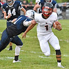 (Brad Davis/The Register-Herald) Oak Hill ball carrier Abraham Farrow gets around Valley defender Caleb Crisp to break loose for a long touchdown run Friday night in Smithers.