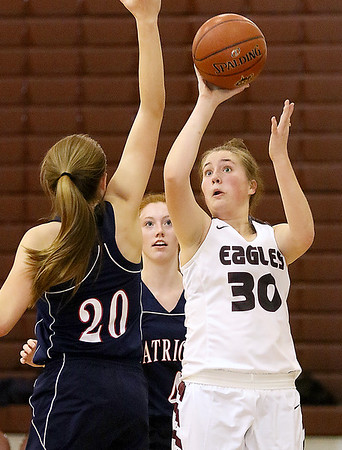 (Brad Davis/The Register-Herald) Woodrow Wilson's Laken Ball drives to the basket as Independence's Emily Suddreth steps up to defend during the Lady Eagles' win on Hall of Fame Friday night.