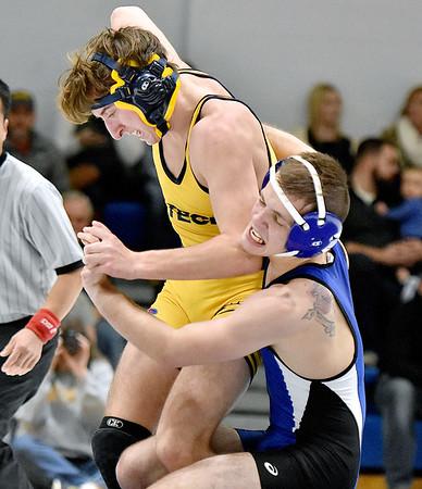 (Brad Davis/The Register-Herald) WVU Tech's Anthony Tripke takes on Ohio Valley University's Judson McCray in 125-pound weight class match Friday night inside the Van Meter Gym. OVU's McCray won the match.