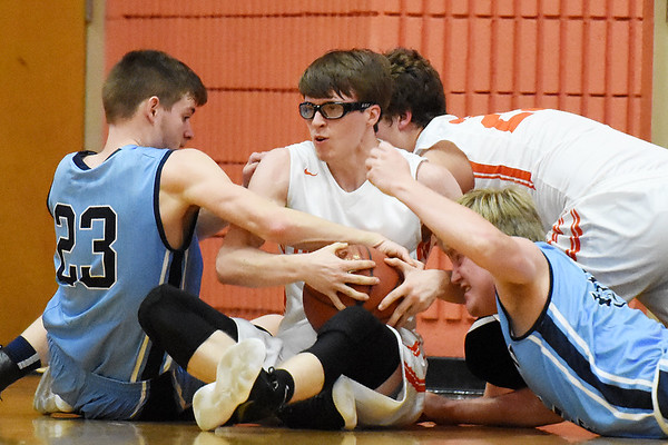 Summers County's Logan Jones (11) tries to get a loose ball from Meadow Bridge's William Woods (23) and Zachory Yates (35) during the first half of their sectional basketball game Monday in Hinton. (Chris Jackson/The Register-Herald)