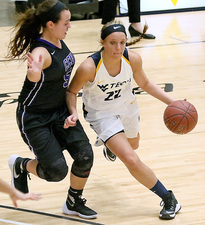 (Brad Davis/The Register-Herald) WVU Tech's Alexandra Combs drives around Cincinnati Christian's Makenzie Tolson Thursday night at the Beckley-Raleigh County Convention Center.