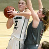 (Brad Davis/The Register-Herald) Wyoming East's Kara Sandy drives and scores as George Washington's Lauren Harmison defends during Big Atlantic Classic action Saturday the Beckley-Raleigh County Convention Center.