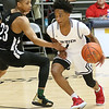 (Brad Davis/The Register-Herald) Greater Beckley Christian's Elijah Edwards cuts around First Love's Isiaiah Wilson during the Little General Battle for the Armory Tournament Friday night at Beckley-Raleigh County Convention Center.