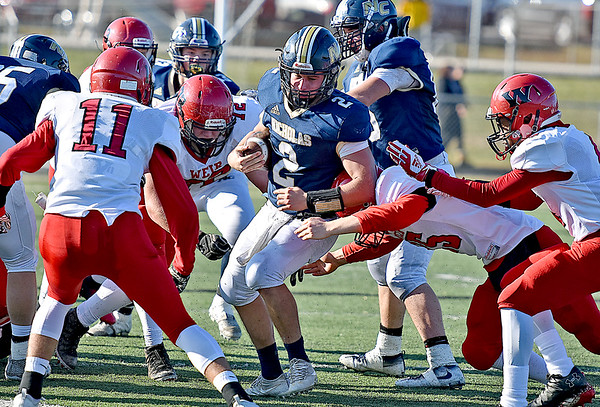 (Brad Davis/The Register-Herald) Nicholas County's Jared Sagraves earns yardage as he pinballs his way through the Weir defense Saturday afternoon in Summersville.