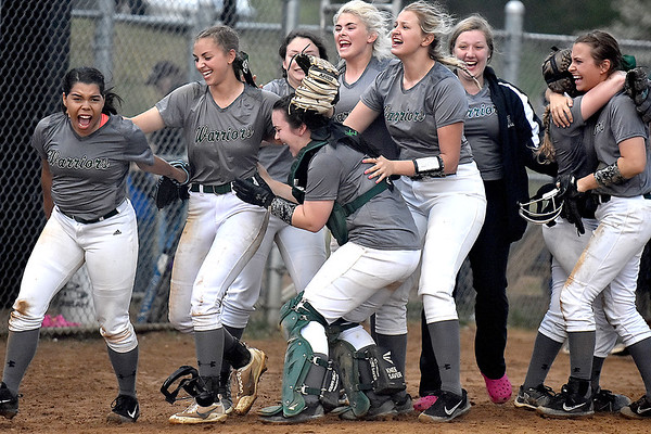 (Brad Davis/The Register-Herald) The Wyoming East Warriors celebrate on the field after taking the sectional championship 4-3 against Independence Friday evening at Liberty High School.