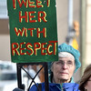 """(Brad Davis/The Register-Herald) An attendee looks on as speakers deliver their remarks during the """"It's Our Time"""" rally marking the one-year anniversary of the Women's March Saturday morning in Beckley's Showmaker Square."""