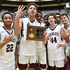 (Brad Davis/The Register-Herald) Woodrow Wilson players hold up fours, the number wins left to earn to bring home a Class AAA state title, after collecting the hardware following the Flying Eagles' Sectional Championship win over the Princeton Tigers Friday night at the Beckley-Raleigh County Convention Center.