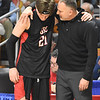 Greater Beckley Christian head coach Brian Helton, right, hugs his player, Brett Riffe after losing to Tug Valley 83-52 during the quarter-final game of the Class A Boys State Basketball Tournament held at the Charleston Civic Center. <br /> (Rick Barbero/The Register-Herald)