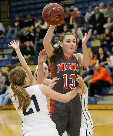 (Brad Davis/The Register-Herald) Summers County's Hannah Taylor leaps to make a pass over Nicholas County defender Emily Parker Wednesday night in Summersville. Taylor hit the 1,000 career points milestone during the game.