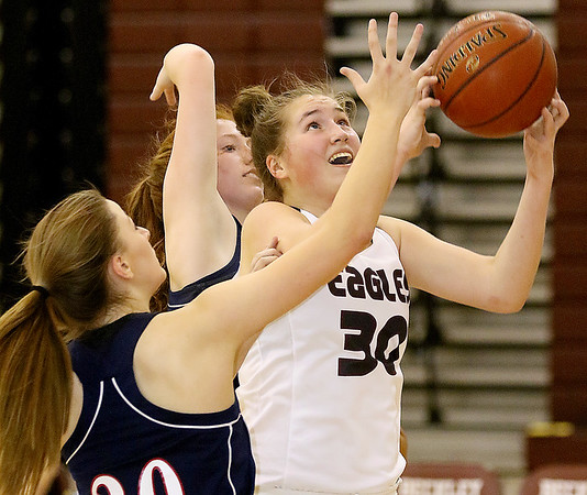 (Brad Davis/The Register-Herald) Woodrow Wilson's Laken Ball drives to the basket as Independence's Emily Suddreth, near, and Lexi Bolen (background) defend during the Lady Eagles' win on Hall of Fame Friday night.