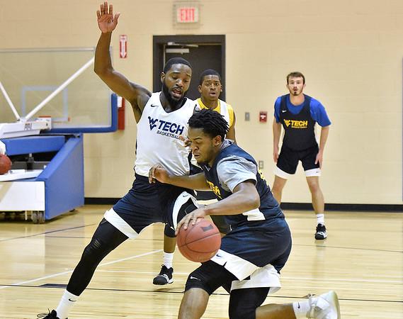 (Brad Davis/The Register-Herald) WVU Tech senior Elisha Boone works through a defensive drill with temmate and former Woodrow Wilson player Nequan Carrington during practice Wednesday evening at Memorial Baptist Church.