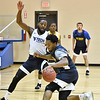 (Brad Davis/The Register-Herald) WVU Tech senior Elisha Boone works through a defensive drill with temmate and former Woodrow Wilson player Nequan Carrington during practice Wednesday evening at Memorial Baptist Church.