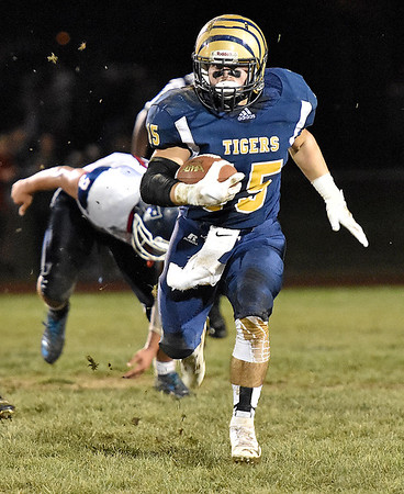 (Brad Davis/The Register-Herald) Shady Spring's Tyler Bragg leaves Independence defenders in the dust as he gets loose for a big gain Thursday night in Shady Spring.