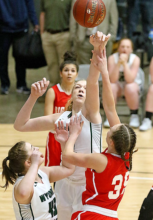 (Brad Davis/The Register-Herald) Wyoming East's Emily Saunders blocks a layup attempt by Parkersburg's Madi Mace during Big Atlantic Classic action Wednesday night at the Beckley-Raleigh County Convention Center.