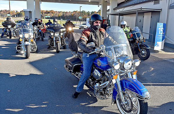 """(Brad Davis/The Register-Herald) U.S. Senator Joe Manchin, right, rolls out of the Tamarack Travel Center in Beckley Sunday morning with a pack of about 15-20 other riders, the first of 12 scheduled stops along a statewide motorcycle tour dubbed the """"Take Me Home"""" ride. Their journey began at Charleston's Cultural Center, stopped first in Beckley then headed south towards Lewisburg, Marlinton, Elkins and Romney before capping the first of the two-day ride in Martinsburg. Today, the senator and anyone who decided to join the ride along the way will roll through Morgantown, Fairmont and Bridgeport before ending the ride and his mid-term election campaign back in Charleston."""