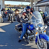 "(Brad Davis/The Register-Herald) U.S. Senator Joe Manchin, right, rolls out of the Tamarack Travel Center in Beckley Sunday morning with a pack of about 15-20 other riders, the first of 12 scheduled stops along a statewide motorcycle tour dubbed the ""Take Me Home"" ride. Their journey began at Charleston's Cultural Center, stopped first in Beckley then headed south towards Lewisburg, Marlinton, Elkins and Romney before capping the first of the two-day ride in Martinsburg. Today, the senator and anyone who decided to join the ride along the way will roll through Morgantown, Fairmont and Bridgeport before ending the ride and his mid-term election campaign back in Charleston."