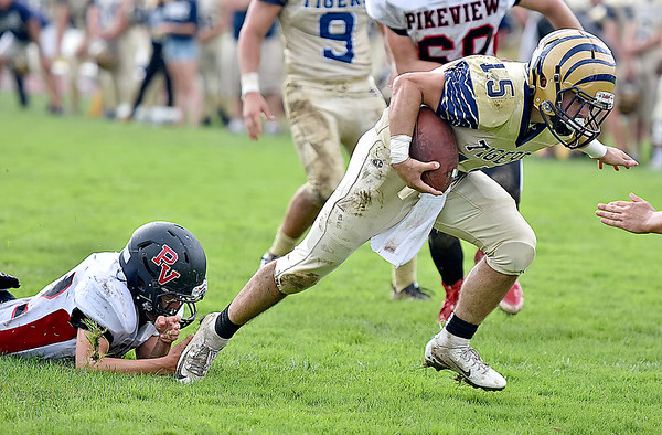 (Brad Davis/The Register-Herald) Shady Spring ball carrier Tyler Bragg gets past would-be Panthers tackler Jacob Honaker, left, to get into the endzone for a 2nd quarter touchdown run in the Tigers' homecoming win over visiting PikeView Saturday afternoon.
