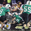 Fayetteville's Jordan Dempsey (9) is tackled in the mud by Sherman's Tommy Harper (5) <br /> during their high school football game Friday in Fayetteville. (Chris Jackson/The Register-Herald)