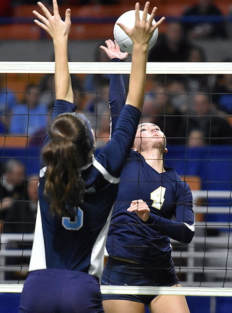 (Brad Davis/The Register-Herald) Shady Spring's Rylee Wiseman leaps to spike the ball as Philip Barbour's Alyssa Hill defends during State Volleyball Tournament action Friday evening at the Charleston Civic Center.