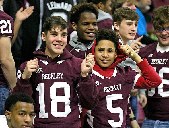 (Brad Davis/The Register-Herald) Woodrow Wilson football team members, along with the boys basketball team, showed up in force to pull for their classmates on the court against Parkersburg South Wednesday afternoon at the Charleston Civic Center.