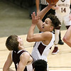(Brad Davis/The Register-Herald) Woodrow Wilson's Eddie Christian drives to the basket as Virginia Episcopal's Bryce Waterman defends during the Little General Battle for the Armory Tournament Friday night at the Beckley-Raleigh County Convention Center.