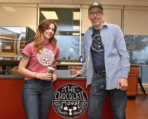 (Brad Davis/The Register-Herald) Chocolate Moose owner Kevin Traube holds and employee Emily Covey pose for a quick photo at the local coffee shop's new Raleigh General Hospital location, which opens Monday, Friday afternoon.