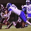 Zachary Weaver, of Woodrow Wilson, left, tries to break away from, Christopher Hudson, of  Capitol, during game at Van Meter Stadium in Beckley Friday Night.<br /> (Rick Barbero/The Register-Herald)