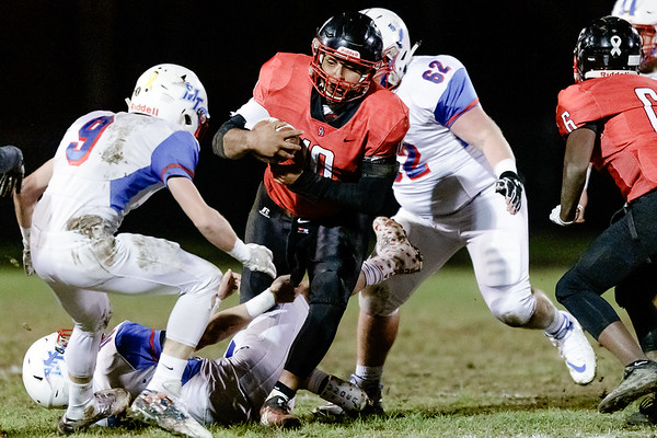 Oak Hill quarterback, Khori Bass, charges through the line of scrimmage. Chad Foreman for the Register-Herald.