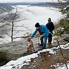 "Anthony Vargo, left, pets his dog ""Rosie"", as Claire Lehotsky, both living in Oak Hill, looks out at fog lingering in the New River Gorge on Beauty Mountain Trail on Monday. (Chris Jackson/The Register-Herald)"