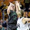 (Brad Davis/The Register-Herald) Wyoming East's Jazz Blankenship shoots from three-point range as North Marion's Brielle Osborne defends Saturday afternoon at the Charleston Civic Center.