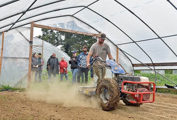 (Brad Davis/The Register-Herald) Sprouting Farms Farm Manager Alex Ogrinz performs a demonstration on proper farming equipment techniques during a WV CRAFT (Collaborative Regional Alliance for Farmer Training) open house style event Sunday afternoon in Talcott.
