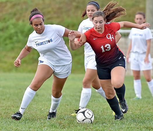 (Brad Davis/The Register-Herald) Oak Hill's Sarah Hale battles for possession with Princeton's Allana Taylor Thursday evening in Oak Hill.