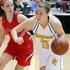 (Brad Davis/The Register-Herald) Greenbrier East's Abby Bartenslager drives to the basket as Morgantown's Cat Wassick defends during Big Atlantic Classic action Saturday the Beckley-Raleigh County Convention Center.