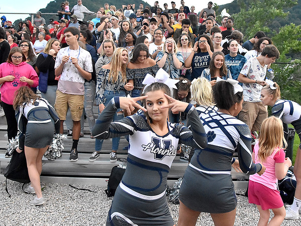 (Brad Davis/The Register-Herald) A Valley cheerleader reacts to the camera Friday night in Smithers.