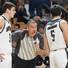 Westside head coach Shawn Jenkins, talks to Travis Cook, left and Shane Jenkins, during game against Winfield in the quarter-final game of the Class AA Boys State Basketball Tournament held at the Charleston Civic Center. Winfield won 68-65<br /> (Rick Barbero/The Register-Herald)