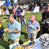 (Brad Davis/The Register-Herald) Incoming students and their families fill their plates during the opening moments of WVU Tech's move-in day picnic Sunday afternoon on the Carter Hall lawn.