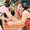 (Brad Davis/The Register-Herald) Liberty's Eric Workman battles Mason's Eddie Moore in a 195-pound weight class matchup Saturday afternoon at the Summersville Arena and Convention Center. Liberty's Workman would win the match.