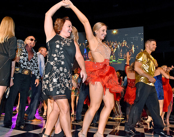 (Brad Davis/The Register-Herald) Fans join the dancers on stage during the closing moments of the United Way of Southern West Virginia's Dancing With the Stars fundraising event Friday night at the Beckley-Raleigh County Convention Center.