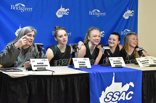 (Brad Davis/The Register-Herald) Wyoming East coach Angie Boninsegna and players (from left) Kara Sandy, Emily Saunders, Katie Daniels and Gabby Lupardus still manage to smile and keep a sense of humor during the postgame press conference despite a loss in the Class AA Girls State Basketball Tournament Saturday afternoon at the Charleston Civic Center.