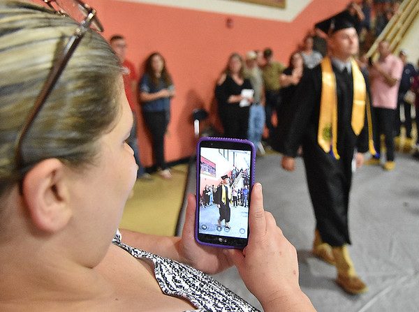 (Brad Davis/The Register-Herald) A family member uses a smartphone to capture the moments of Summers County High School's graduation ceremony Friday evening in Hinton.