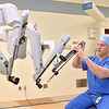 "(Brad Davis/The Register-Herald) Dr. Scott Killmer, a surgeon at Raleigh General Hospital, shows how specific surgical instruments are attached and applied as he demonstrates how the da Vinci robotic surgical system, a.k.a. ""The Robot"" works during a Register-Herald visit to the hospital Friday afternoon. He just completed his 500th surgery using the da Vinci system."