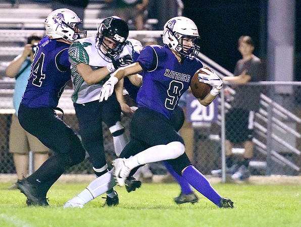 (Brad Davis/The Register-Herald) James Monroe's Xander Castillo turns up field for a long touchdown run after making a catch Friday night in Lindside.